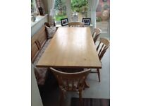 Lovely 6ft pine table and four chairs .