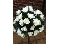 Two artificial white rose trees.