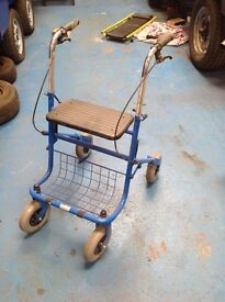 4 wheel blue walker with seat and brakes