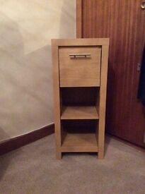Small display unit light oak 82h - 34w 34d exc condition £40 Ono.