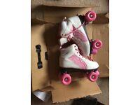 Girls uk 7 roller boots