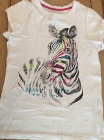 Girls age 11-12 year short sleeved top.