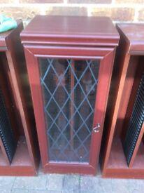 Cd cabinet with glazed door