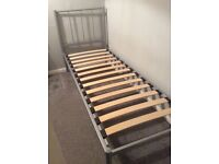 Small single silver metal bed frame