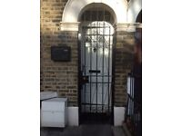 Wrought black security gate