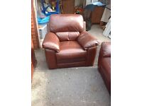 Brown leather 2 piece suite. 3 seater settee and an armchair. Really soft leather