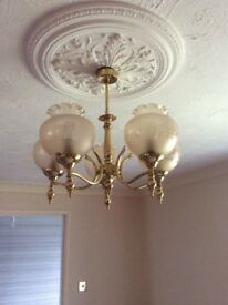 Two hanging Gold effect ceiling lights and matching switches