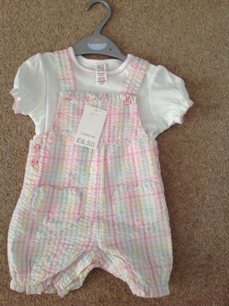 Brand New Baby 2 Piece setin Benfleet, EssexGumtree - Beautiful brand new, labels attached, kept in pet & smoke free environment. Age 6 9 months, cost £8.50 from TU. Pink, Yellow, White & Green check with pink flower buttons. White t shirt with pink piping. Very cute