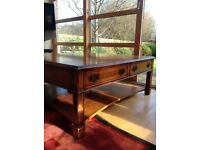 Victorian style walnut coffee table with four drawers and magazine shelf. 120cm x 120cm x 45cm high