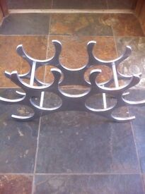 Chrome metal wine bottle stand