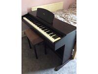 Yamaha YDP121 electric piano and stool