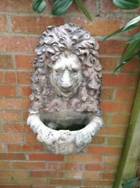 Stone lions head. Fountain or planter