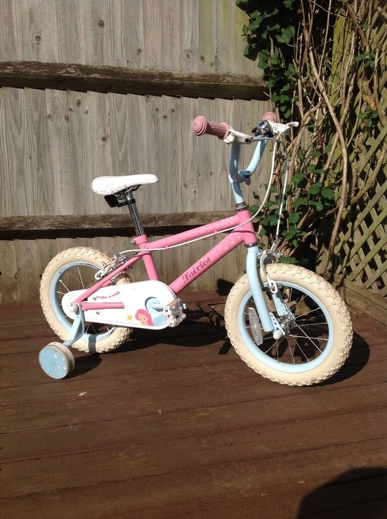 """GIrls 14"""" Fairies Bike with stabilisersin Staines upon Thames, SurreyGumtree - A lovely girls first bike complete with removable stabilisers. It still retails at £60. This bike is a used item but in good condition. First to see it will buy. Come and see it! Laleham"""