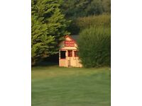 Childrens large and Lovely wooden playhouse