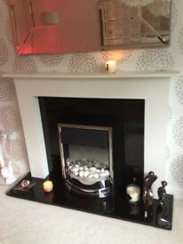 Fireplace with black granite hearth and back