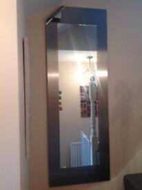 Tall designer mirror for sale.