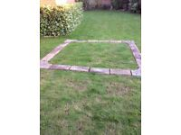 Concrete stone-style pond surround consisting 20 slabs including 4 shaped corners, 9'x9' approx