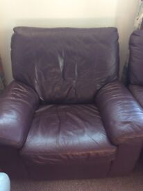 Two leather electric reclining armchairs