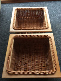 Two wicker baskets for kitchen storage, with runners, used