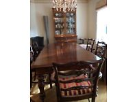 Antique mahogany extending dining table and chairs. Superb condition .