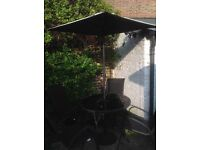 Garden patio table with Parasol and four stacking chairs