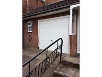 """White garage door up and over. Excellent condition. 7'-7""""x6'-7"""" Dismantle and carry away yourself."""