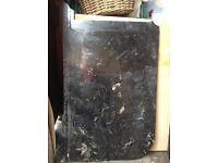 Black granite worktop curved at one corner appros 3' by 2'