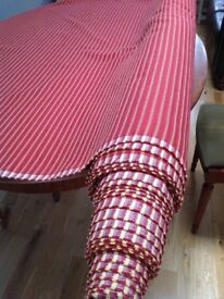 Large bale of beautiful thick red curtain or cushion fabric
