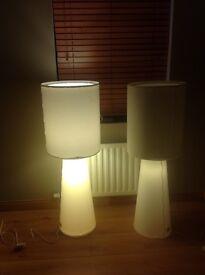 2 white floor lamps