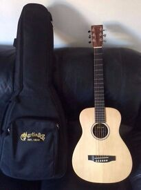 Martin LX1E with Padded Case and Capo.