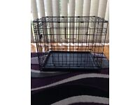 Small black dog cage