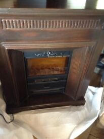 Electric Fire with wood surround. Solid piece of German furniture.