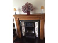 Cast iron /tiled open fireplace and wooden mantle/surround