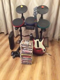 PS3 with full Rock Band kit and 23 Games!