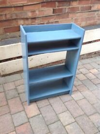 Blue wooden bookcase