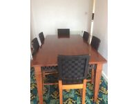 Solid dark wood table and 8 chairs