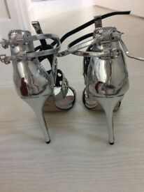 Fabulous Carvela silver high heels never worn size 5