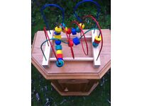 Early Learning Centre wooden abacus with dirrerent shaped wooden blocks.