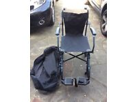 Wheelchair collapses into hold-all excellent condition hardly used collection only