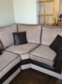 Nearly new beige/brown fabric corner sofa and matching chair.