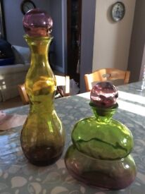 Two glass colourful bases. One is tall and the other medium high.