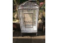 Large parrot cage, restored to excellent condition, on wheels so easy to move from room to garden .