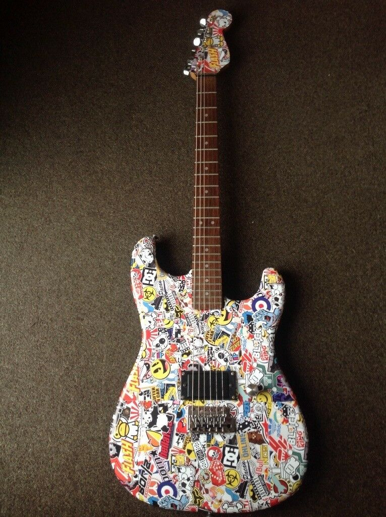 encore sticker bomb punk rock electric guitar with gigbag strap in corby. Black Bedroom Furniture Sets. Home Design Ideas