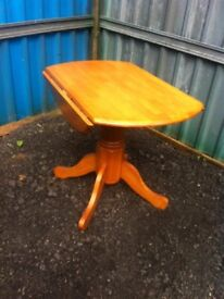 Julian Bowen solid pine pedestal drop leaf dining table in great condition