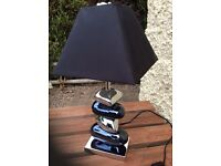 Pebble effect black and silver table lamp