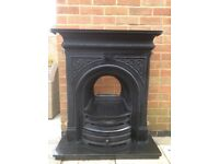 Black cast iron fire surround and hearth