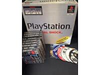 PS1 with games in the box
