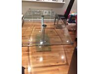 Rolf Benz glass table for sale, fits 6 chairs.