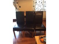 Three brown leather chairs