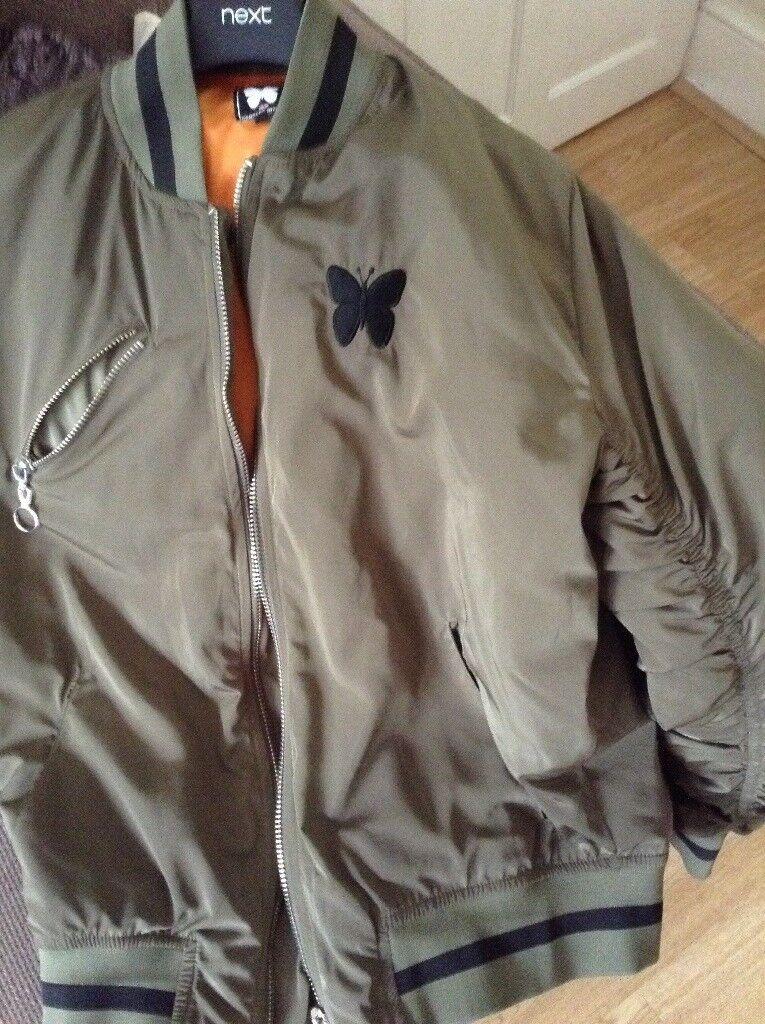 Ladies/gents green jacket brand new